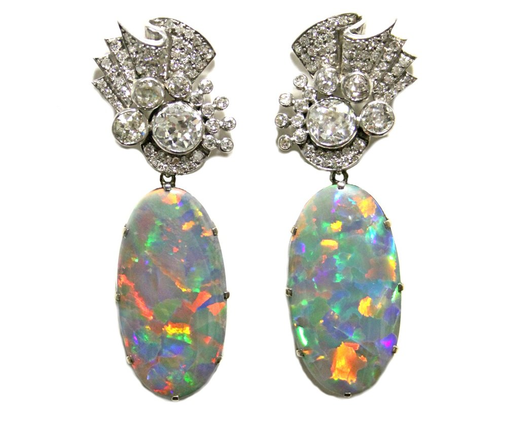 Sold For 18,500  A fine pair of Black Opal & Diamond earrings