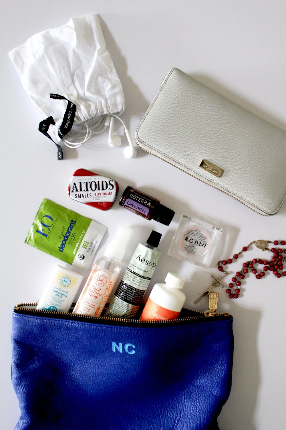REBECCA MINKOFF POUCH  /  HONEST SUNSCREEN STICK  /  HONEST HAND SANITIZER SPRAY  /  AESOP HAND CREAM  /  BULLETPROOF BRAIN OCTANE OIL  /  EO ORGANIC DEODORANT WIPE   / DOTERRA LAVENDER ESSENTIAL OIL /  RODIN LIP BALM  /   KATE SPADE WALLET