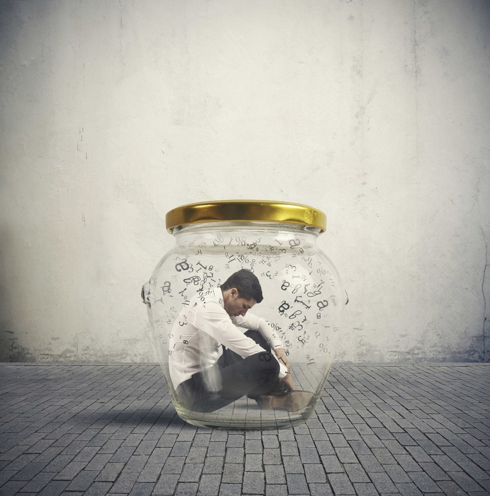 Man in a bottle feeling overwhelmed and stuck in his life