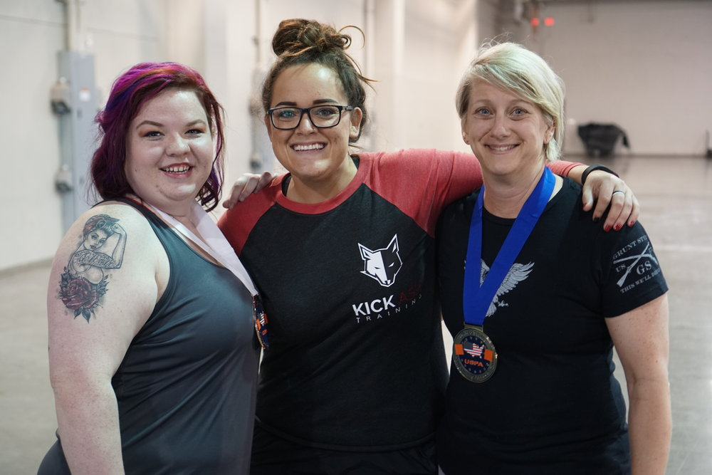 Coach Ashley Day (center) with two of her lifters at the OKC Fit Expo