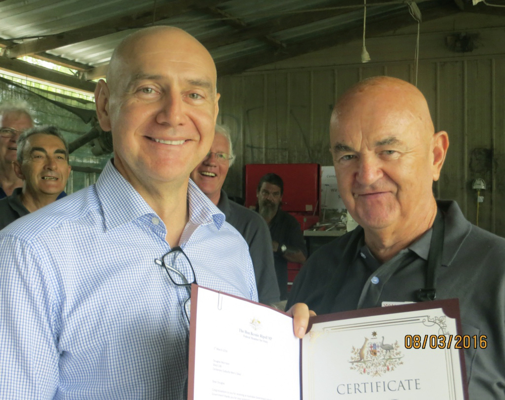 Presentation of Volunteer Award Certificate by The Hon Bernie Ripoll MP to Doug Morrison