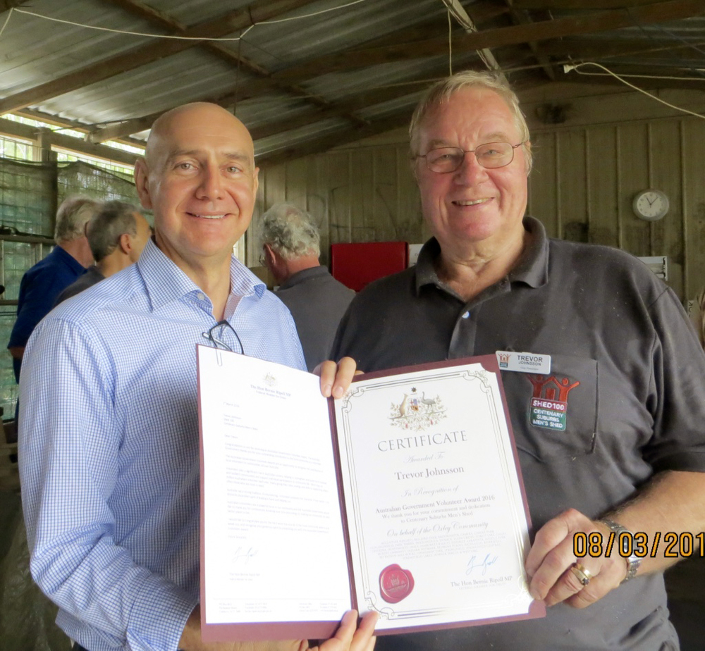 Presentation of Volunteer Award Certificate by The Hon Bernie Ripoll MP to Trevor Johnsson