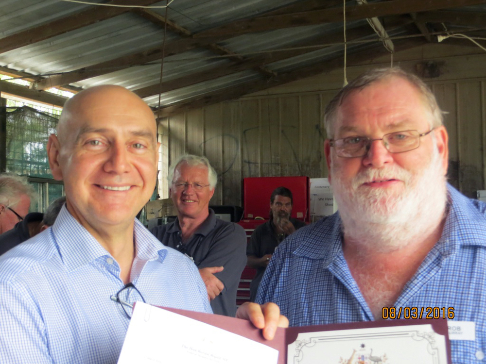 Presentation of Volunteer Award Certificate by The Hon Bernie Ripoll MP to Rob Murray