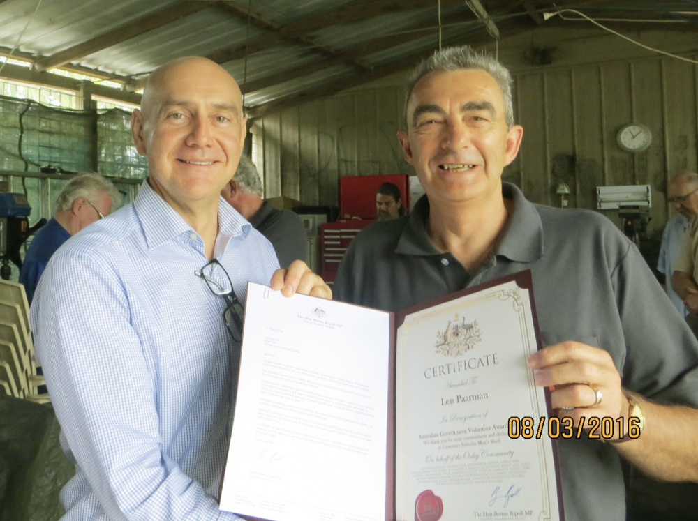 Presentation of Volunteer Award Certificate by The Hon Bernie Ripoll MP to Len Paarman