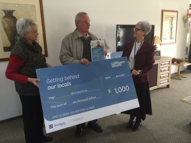 Vice president trevor johnsson accepting the stockland community grant on 27th july