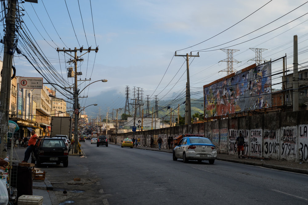 Typical scene in Rio de Janeiro, with lush green mountains surrounding the dense urban jungle. This is a neighborhood called Madureira.