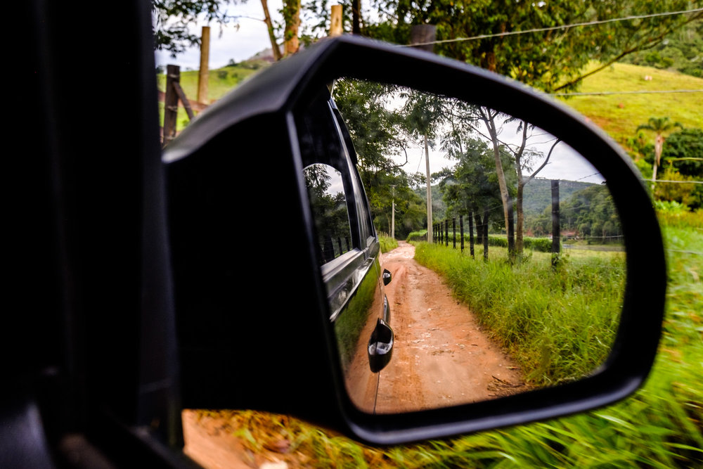Getting to the secret spot involved a lot of bumpy, muddy dirt roads. Note the classic red/orange soil in Brazil.