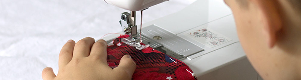 machine sewing close up_1500x400.jpg