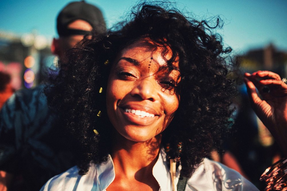 Black Woman Smiling in the Sun