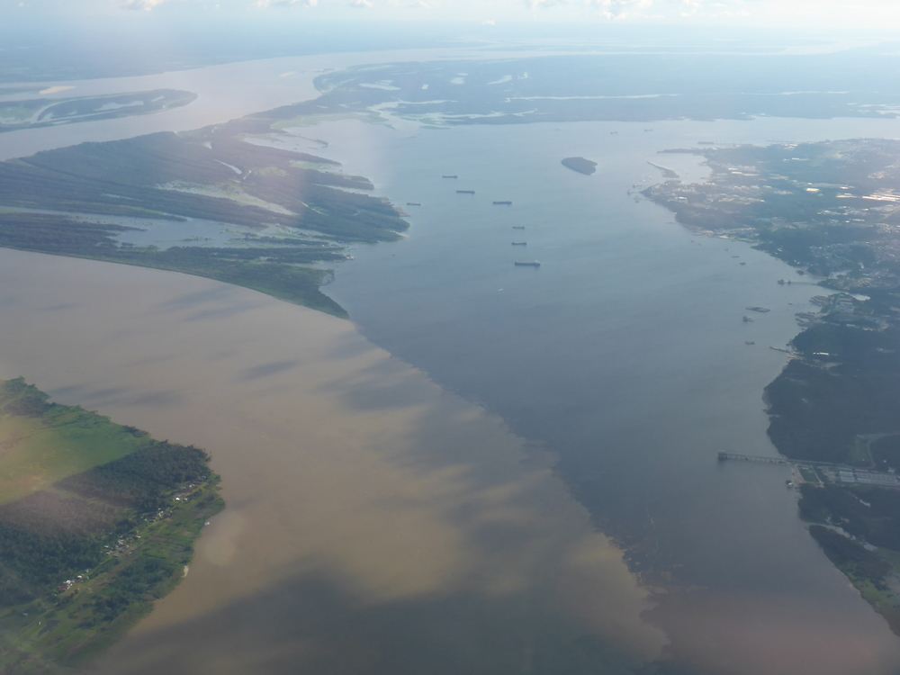 encontro das aguas - 'meeting of waters' where the rio negro and rio solimoes meet near manaus