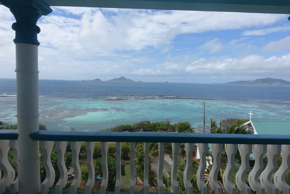 on the balcony at st joseph's house overlooking the church on union island