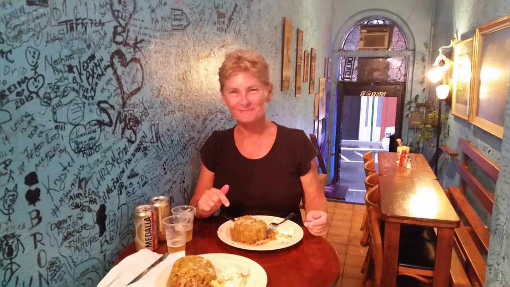 cally enjoying a mofongo in san juan