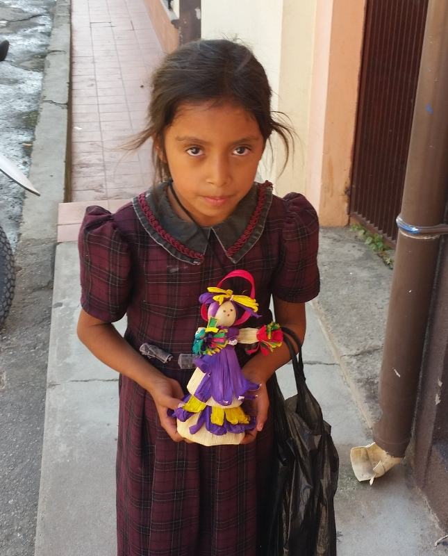 young mayan girl, copan ruinas selling Muñecas- hand made dolls