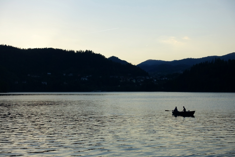 the sun sets over lake bled and day 1.