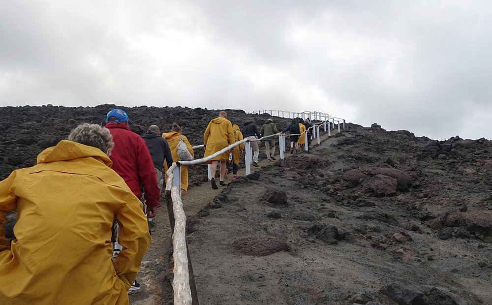 tourists heading to the crater of mt yasur