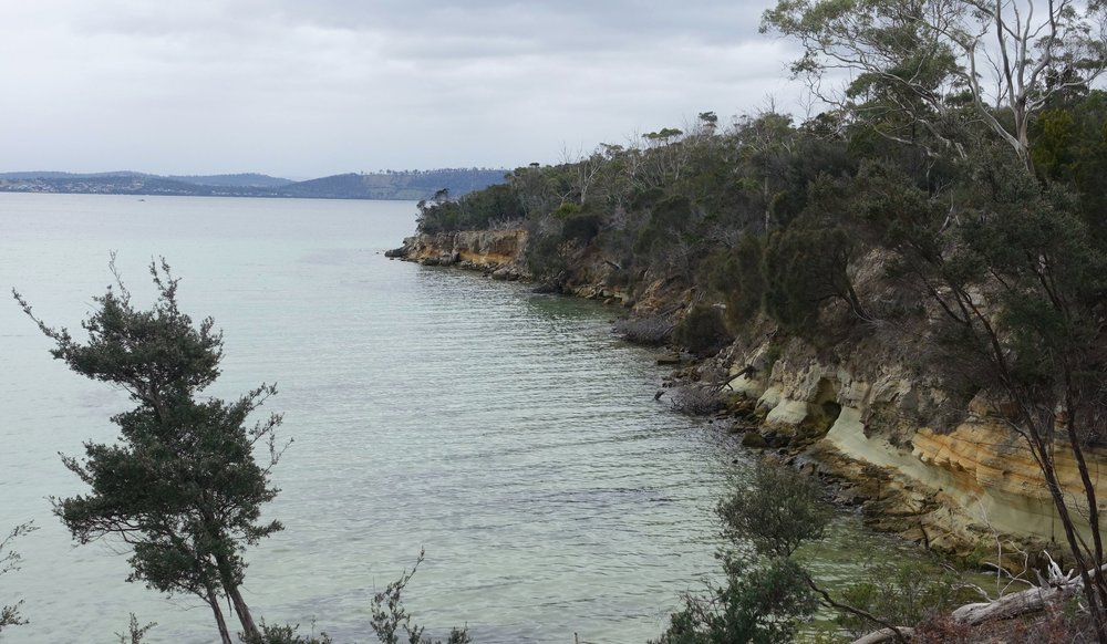 the track headed out along this small headland at the end of lime bay beach