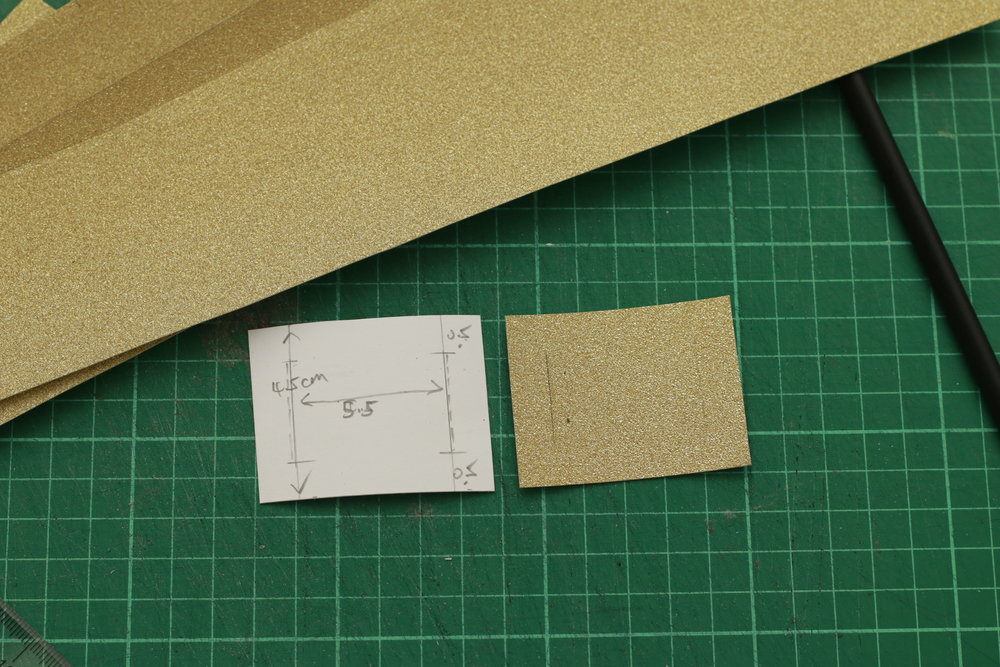 4.5cm x 5.5cm with 0.5cm on each side