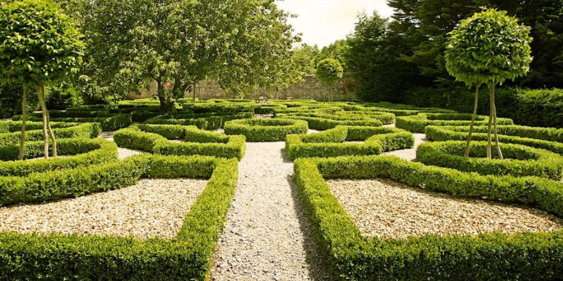 The formal knot garden is based on a design by Walter Stonhouse.