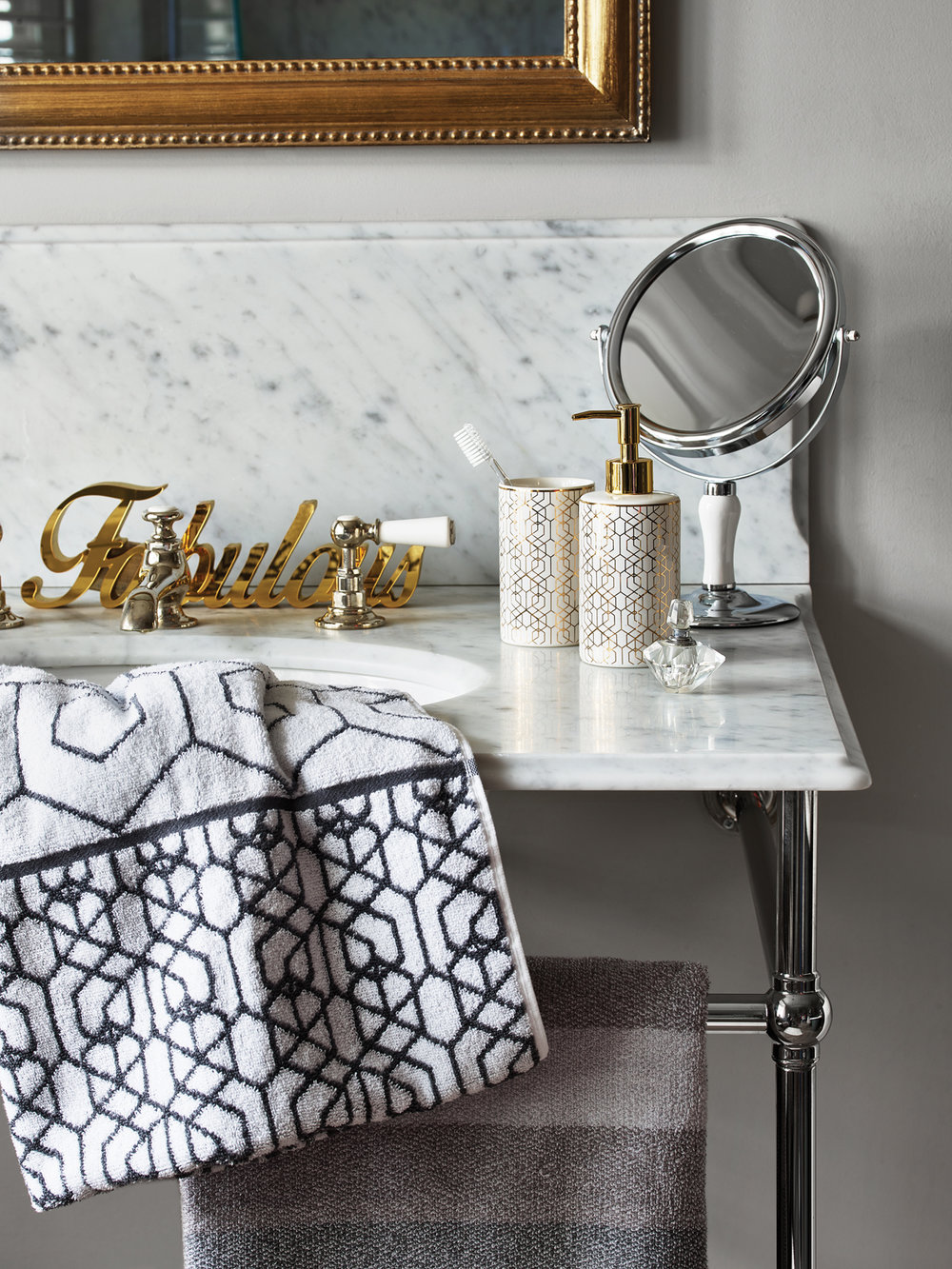 'Fabulous' bath sign - £6, Gold Geo tumbler - £3, Gold Geo dispenser - £5, White and Chrome stand mirror - £8, Grey Geo bath towel - £6, Savoy Stripe bath towel - £6.