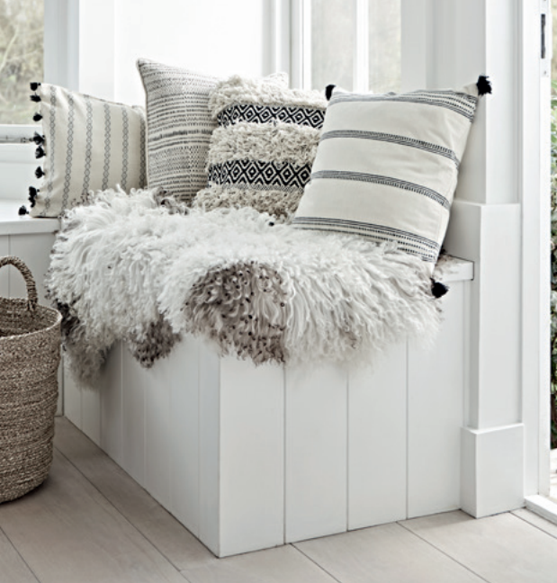 Cushions L-R: Maya tassled cushion £45,  Dash piped cushion £45,  Fora tufted cushion £30,  Ilda striped cushion £35.