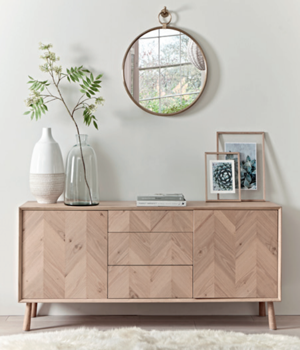 Chevron oak sideboard, £1125.  Aura brass mirror, £225.   Sumptuous sheepskin quad rug, £325.