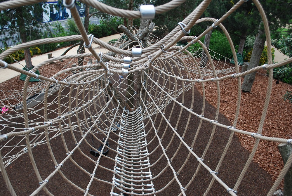 Fully enclosed net walks are safe, but transparent, providing a balance of risk and fun at Tumbling Bay Playground
