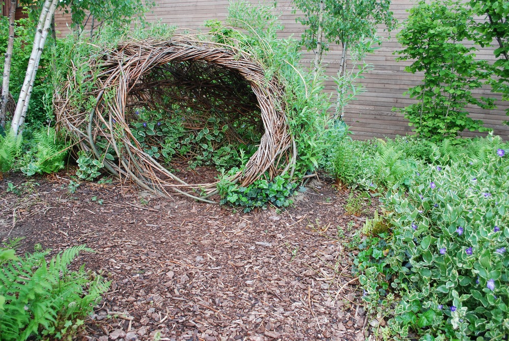 Woven living willow dens at Tumbling Bay Playground