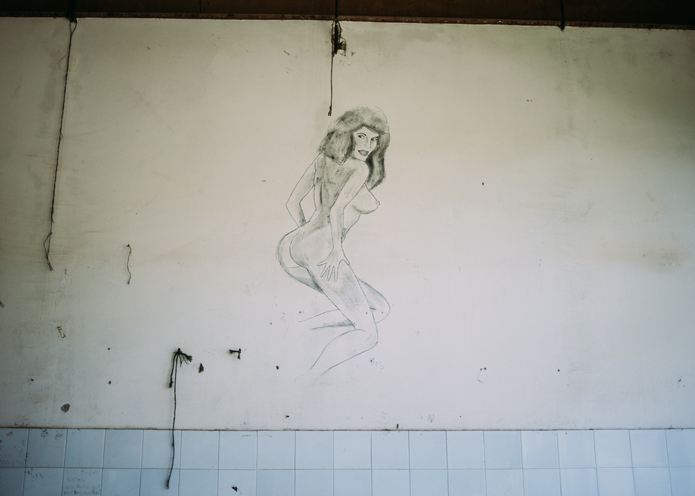 Graffiti adorns the walls of an abandoned former UN building in Srebenica.