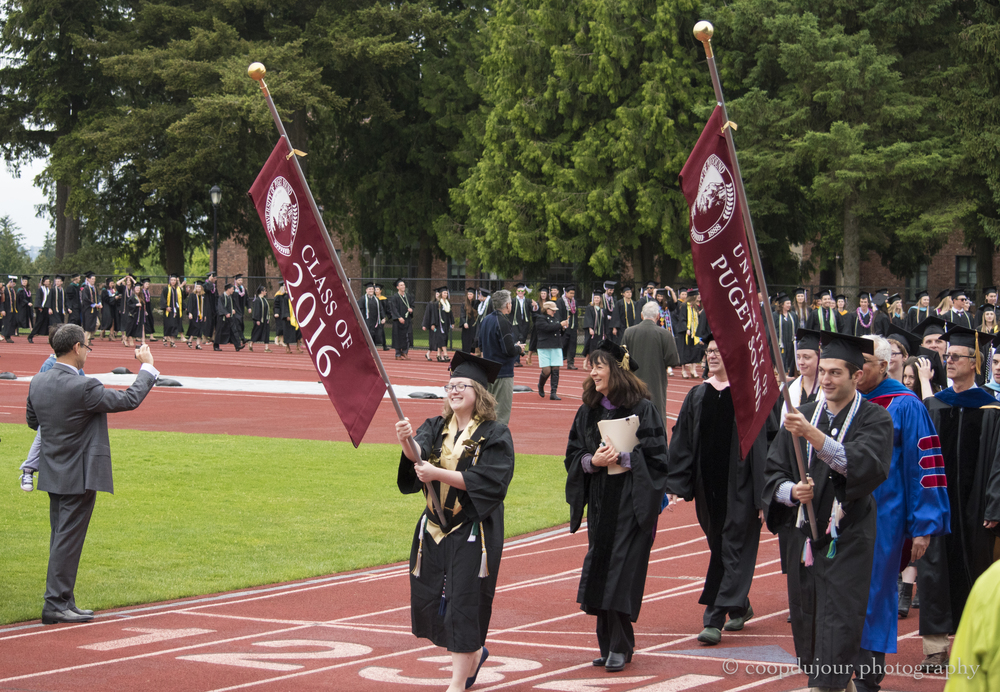the graduates parade in to the stadium
