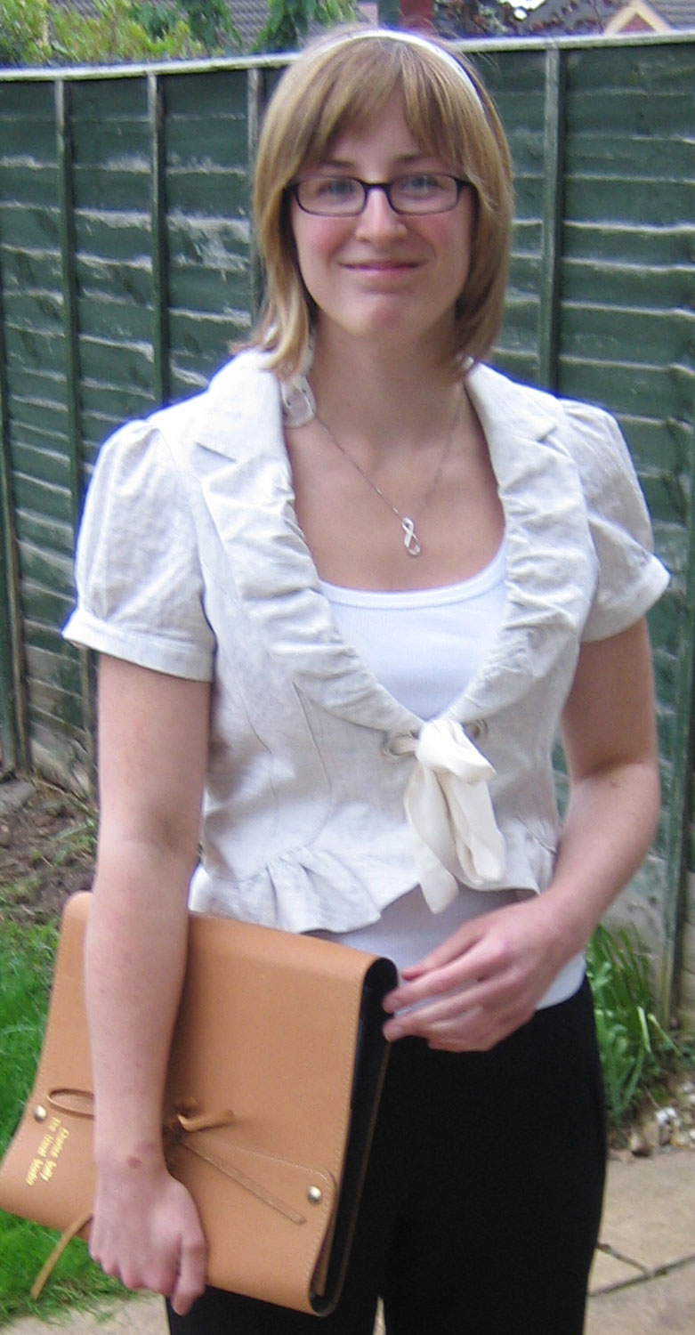 Me in 2007, showing off the new leather embossed portfolio I had made