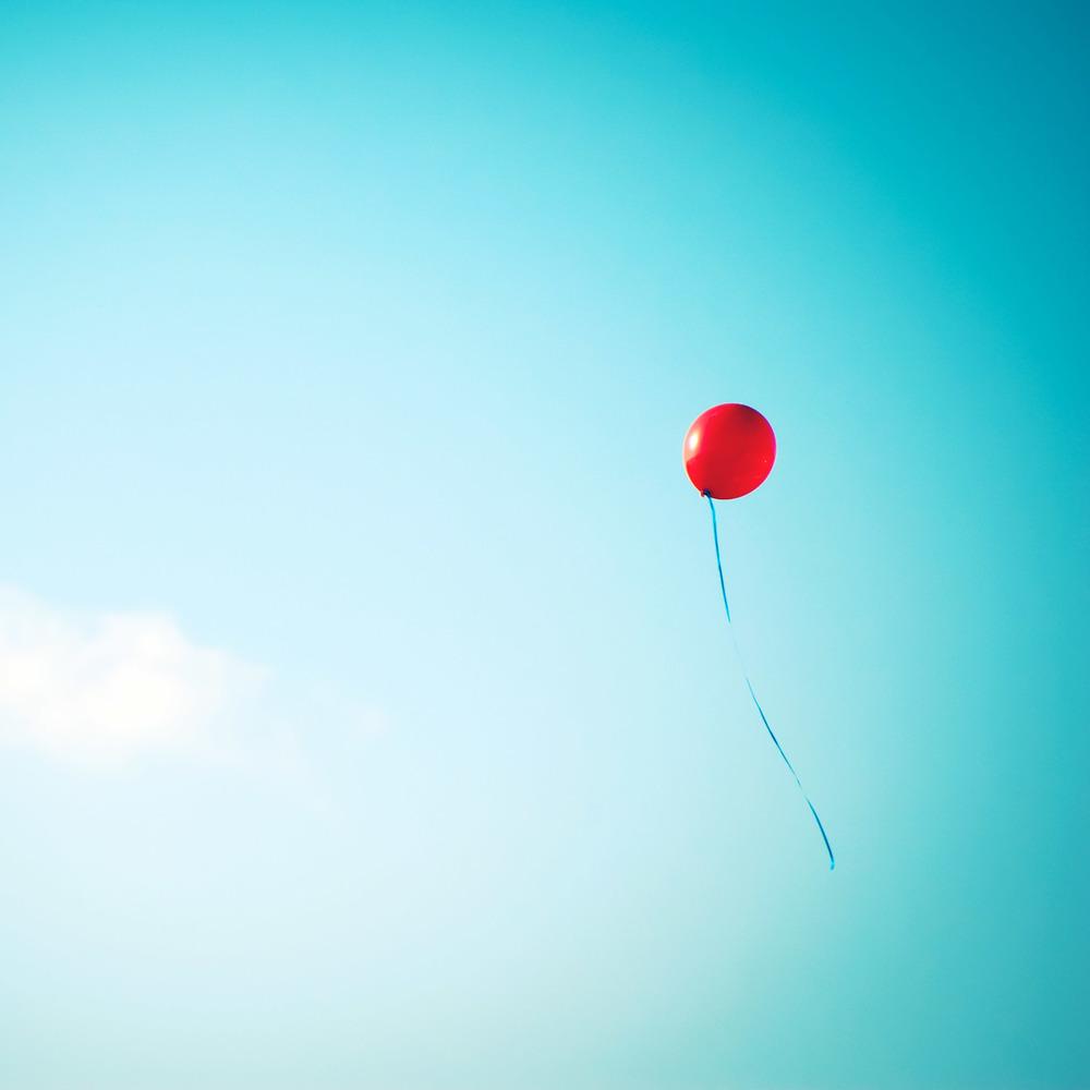 Red Balloon In Blue Sky iPad Wallpaper HD.jpg