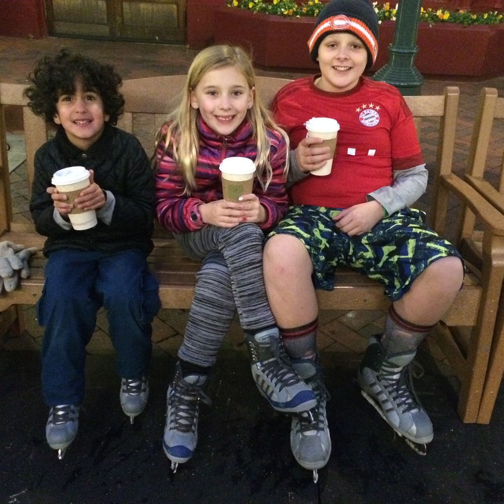 A hot chocolate celebration after Aubtin (left) could join the big kids free wheeling on the ice rink.