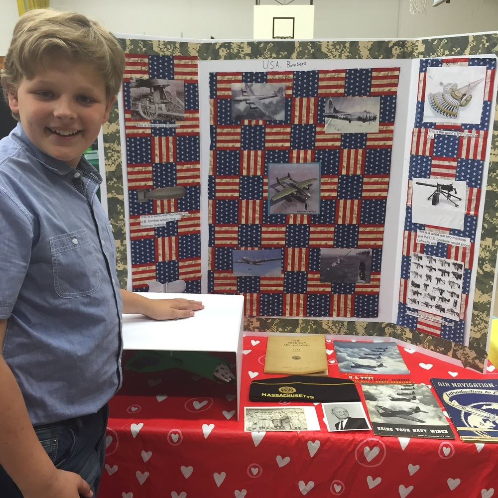 Sam with his project, and some of his great grandfather's treasures from World War II.
