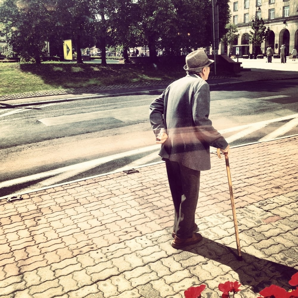 Old man walking in Warsaw