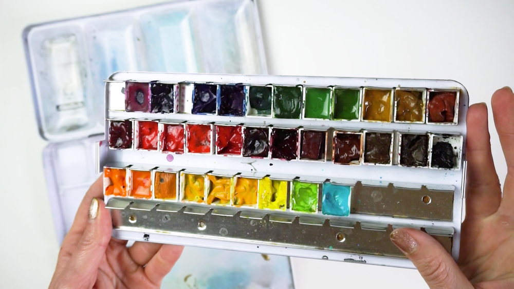 My everyday watercolor palette extraordinaire! (A Schmincke aluminum 50 half-pan palette filled with an assortment of paints)