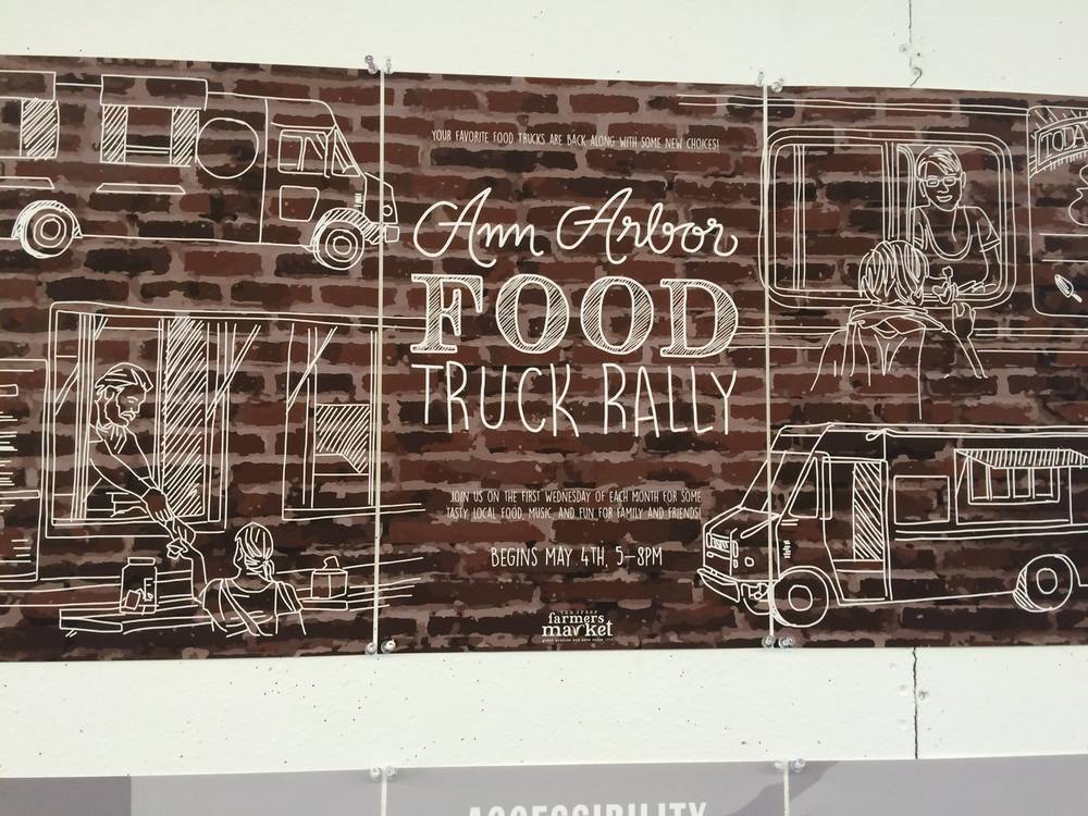 Not all of this week's event were sunny.  This is the only photo of this season's 1st Ann Arbor Food Truck Rally that came out.  The weather was overcast, cloudy, rainy but the crowds still came.