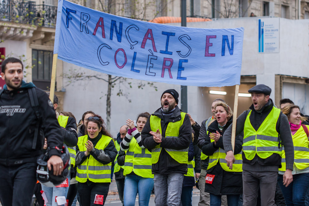 """The French """"Yellow Vest"""" movement (the vests are really green, but since the French are notorious contrarians, they're called """"yellow"""") provides a preview of U.S. protests against raising gas prices enough to make a difference in carbon emissions."""
