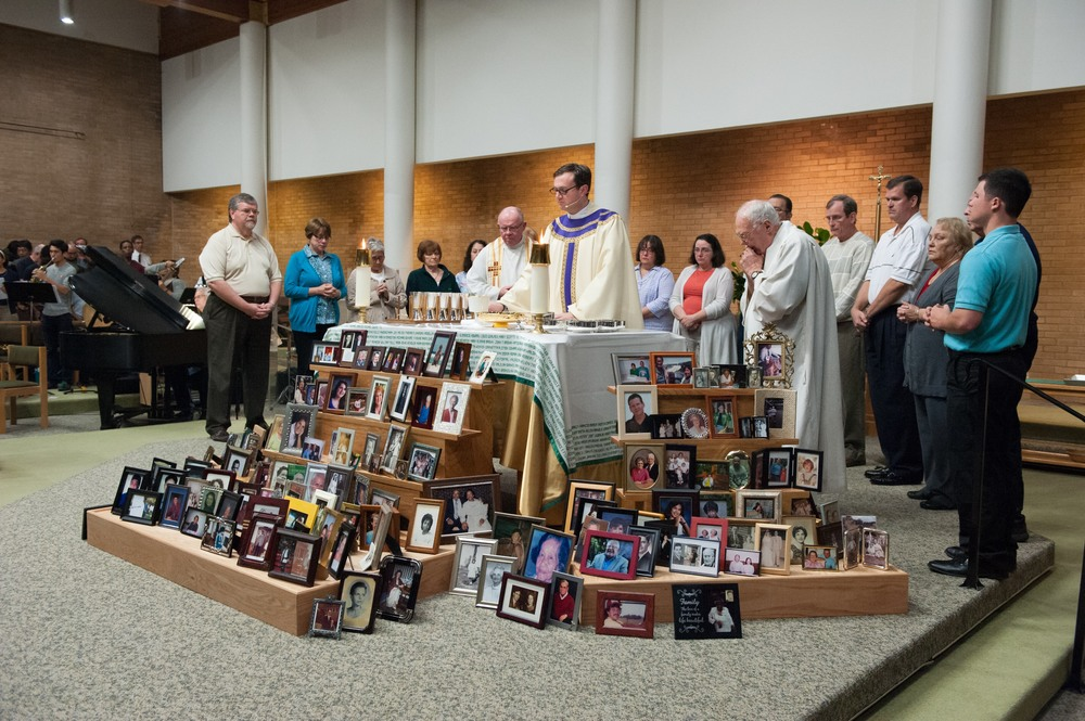 Nov 2015:  Photos of parishioners' loved ones who have passed surrounding our altar for All Souls.