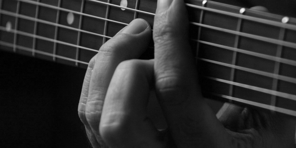 guitarfingersonstrings.jpg