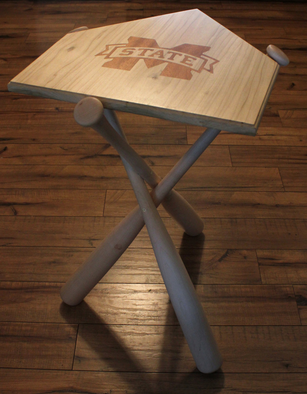This table was made for the MSU Women's Softball team. The maroon inlay is Sapele Mahogany..