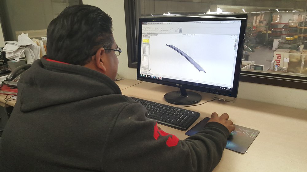 Our Digital Engineer using the new Solidworks 3d program on our NEW computer system