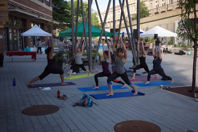Practicing yoga at the Historic Brookland Farmers Market, Aug 2015 Photo credit: Andrew Krieger