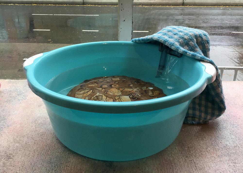 In the water's ripple I hear my echo, 2016  stoneware, water, aquarium pump, towel, plastic basin  16 x 17 1/2 x 6 inches