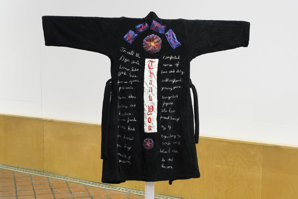 Biker Regalia, 2017  embroidered acrylic fleece, satin and linen, wooden and metal stand  10 x 55 x 64 inches