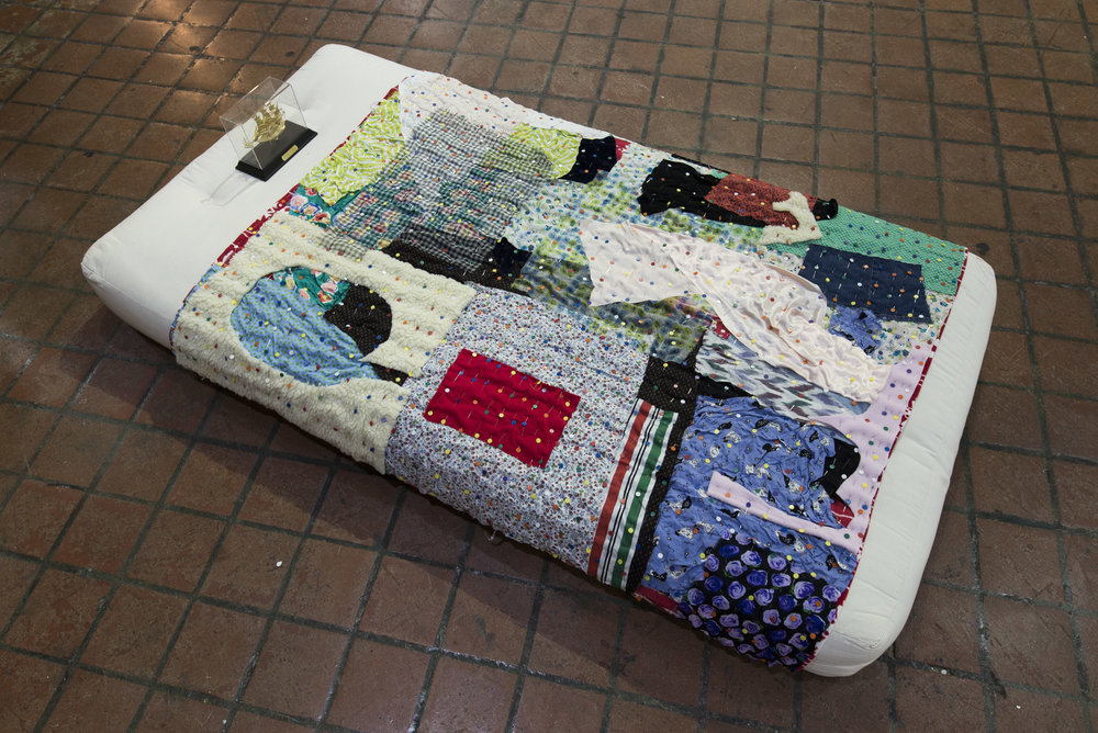 Little Vessel; or, leaving home and hoping to make everyone proud, 2017  Personal fabric scraps, 1000 pins, twin mattress, gift boat  75 x 38 x 12 inches