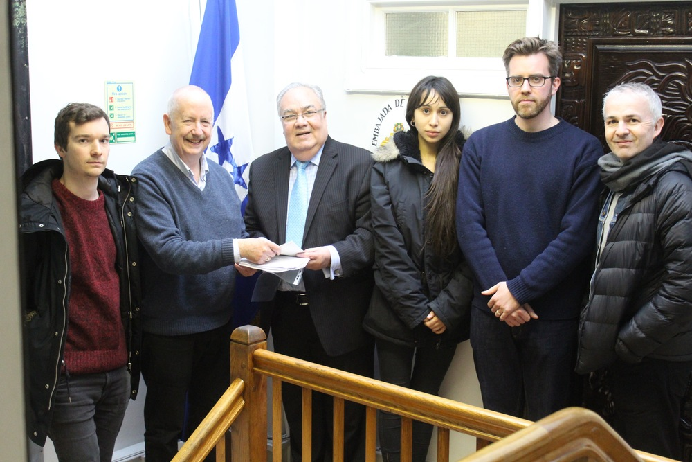 Members of the Haldane Society of Socialist Lawyers hand in a petition to the Honduran Embassy in London.