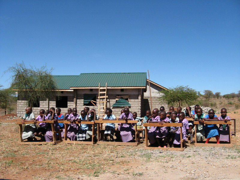 Meidenyi School children awaiting our arrival for the dedication of their new classroom. Photo by Kate Harnedy.