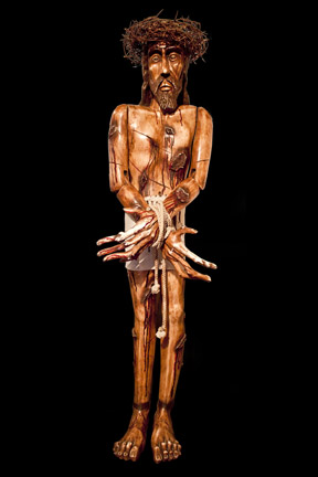 "This carving, called ""Ecce Homo"" by Benjamin Lopez, is found in the Santuario de Chimayó in New Mexico."