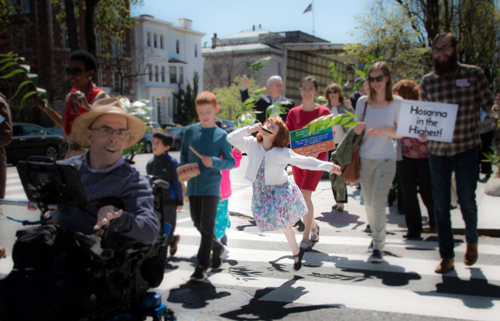 Children participating in our Palm Sunday Parade
