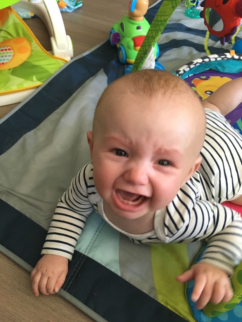 Unhappy 7 month old who does not want mama to cook!